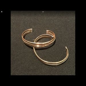 Jewelry - 2 sterling silver - 12 K gold bangles.